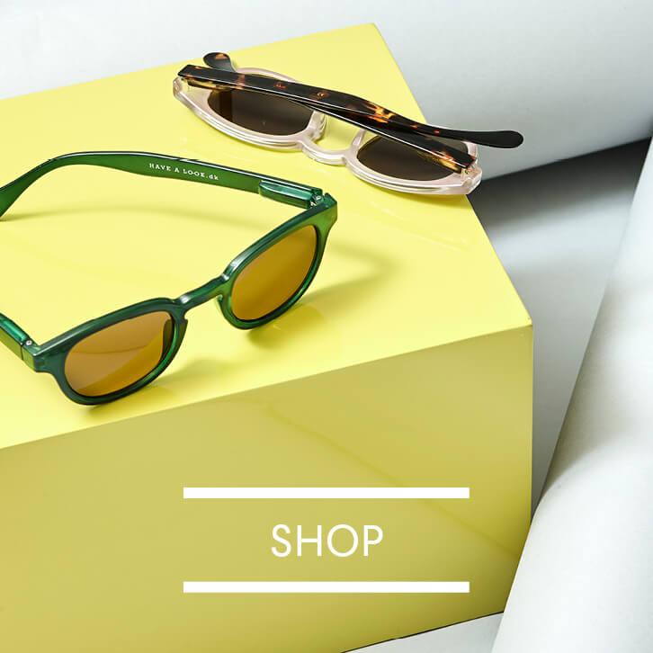 Solbriller med l&aelig;sefelt <br>